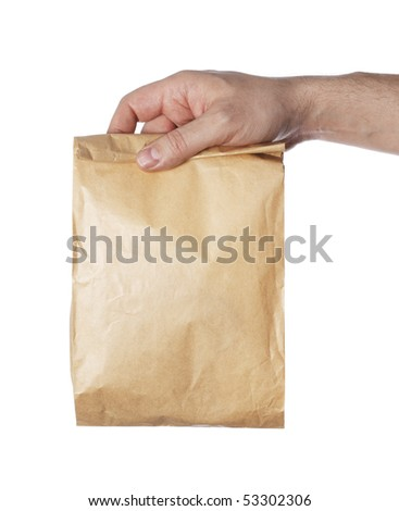 Man holding a brown paper bag in his hand.