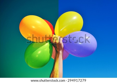 man holding a bunch of balloons of different colors before (right) and after (left) applying a filter during the image editing process