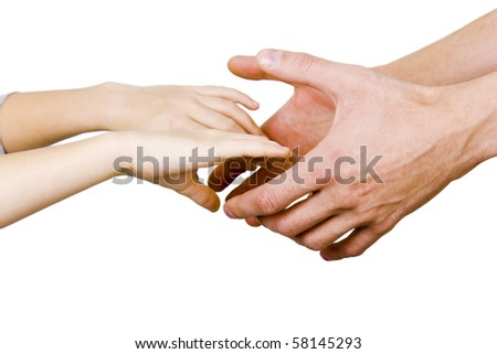 man holding a child's hands on a white background