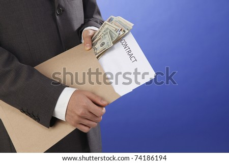 man holding a contract and money