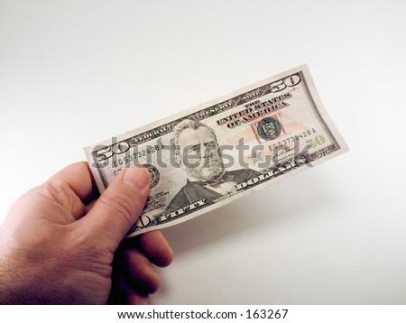 Man holding a $50 dollar bill.