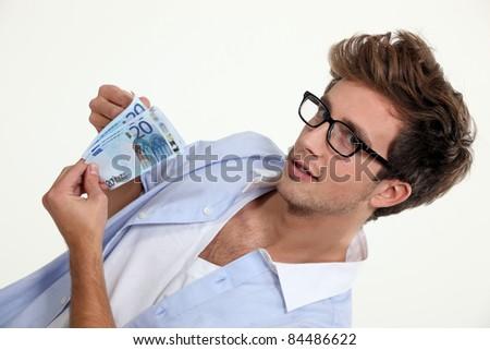 man holding a dozen of banknotes