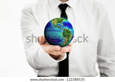 Man holding a earth globe in his hand, Earth image provided by Nasa -http://www.nasa.gov/topics/earth/earthday/gall_ocean_chrom.html