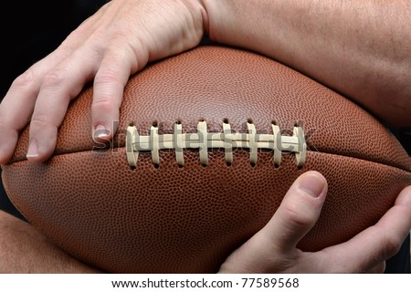 man holding a football