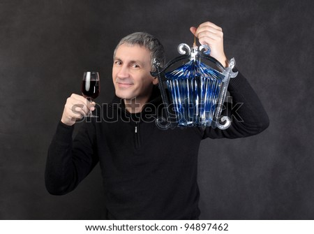 Man holding a glass wine and lantern, on gray background