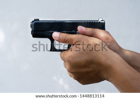 Man holding a gun white background,How to hold the gun correctly,Short gun,Noisy killing weapon,Deadly weapon #1448813114