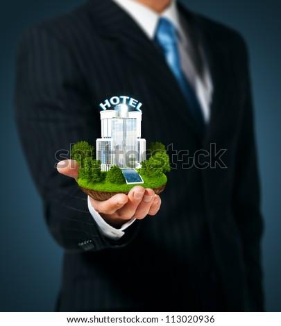 Man holding a hotel in hand