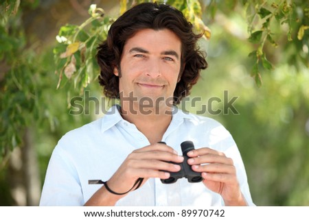 Man holding a pair of binoculars