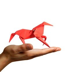 Man Holding a Paper Horse in hand. Motivation concept : Believing in your our dreams