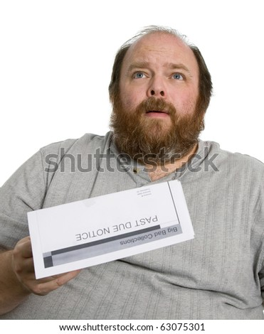 Man holding a past due notice and looking very worried