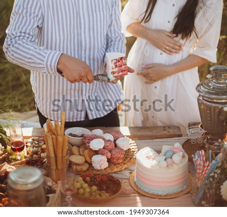 man holding a piece of cake in his hands. a man treats a woman with a birthday cake. hungry woman waiting for her portion of cake. a well-fed woman is not ready to eat a piece of cake.