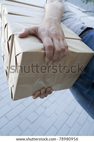 man holding a pile of package parcels