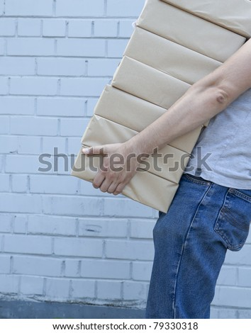 man holding a pile of package parcels - stock photo