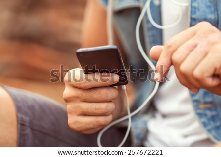 man holding a Player, listening to music