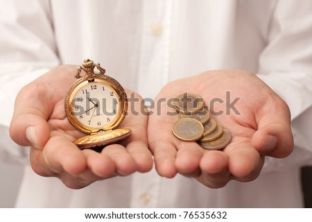 man holding a pocket watch and money