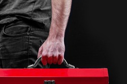Man holding a red tool box