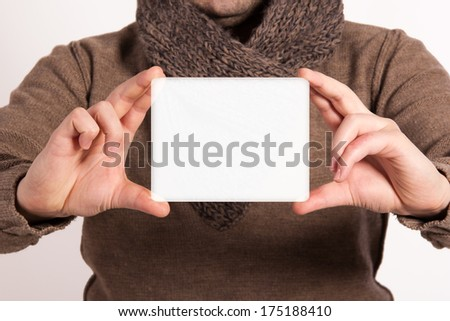 Man holding a sign for the label. Young man showing the place of words and writing in it. Close up of a businessman showing blank placard. Space for text. Isolated on white background.