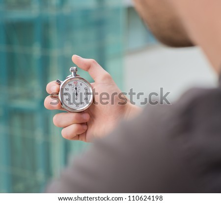 Man Holding A Stopwatch