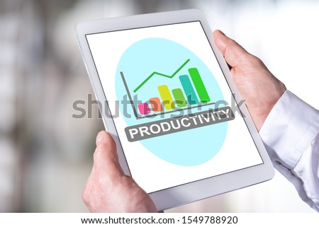 Man holding a tablet showing productivity concept