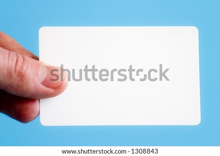 Man holding a white business card on a light blue background