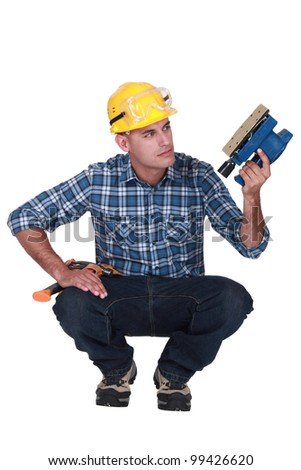 Man holding an electric sander