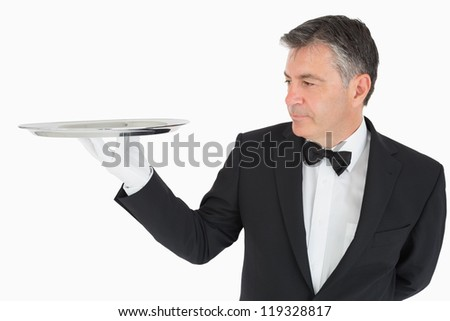 Man holding an empty silver tray