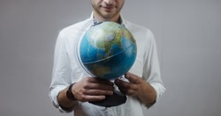 Man holding an globe in his hands. Concept of worldwide education