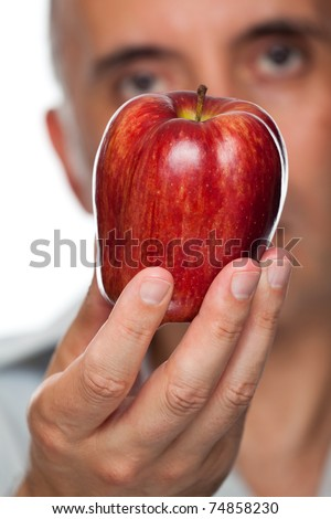 Man holding apple up close