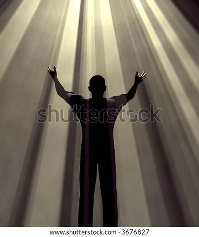 Man holding arms up in praise against light rays