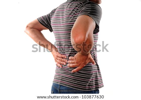 Man holding back who is suffering from lower back pain