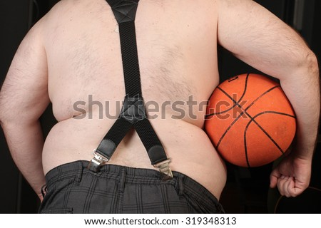 man holding basketball ball . Big belly obese men. Disease and metabolic disorders.