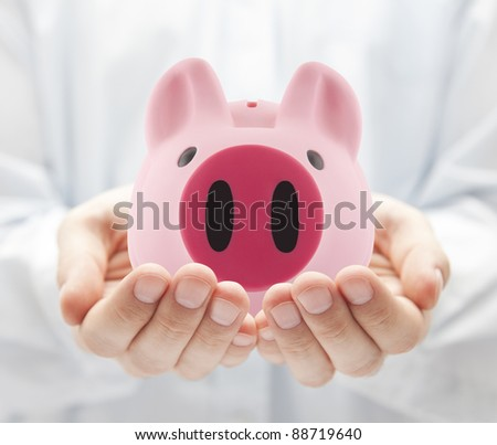Man holding big pink piggy bank