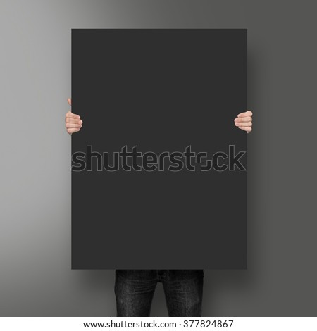 Man holding black poster mockup on the blank background #377824867