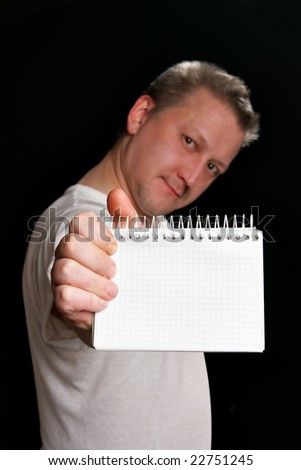 Man holding blank notebook, put your own text here. Focus on the notebook!