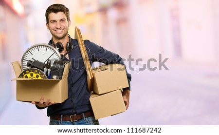 Man Holding Box And Picture Frame, Background
