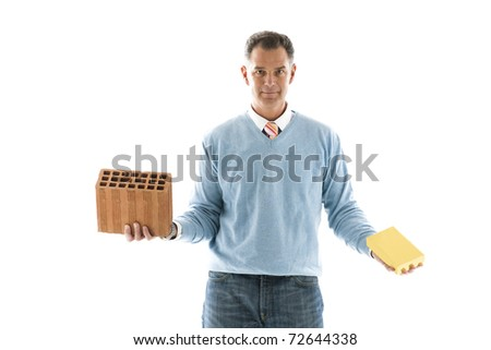 Man Holding brick and a gold bar; Concepts: investing on houses or financial investment