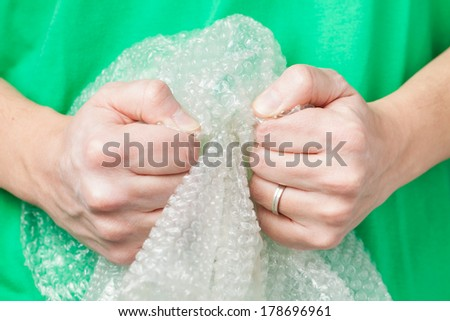 Man holding bubble wrap, stress relief