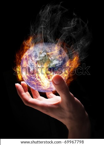 Man holding burning Earth in his hand as a symbol of global warming or an apocalypse. Earth globe image provided by NASA (http://visibleearth.nasa.gov/view_rec.php?id=2429).