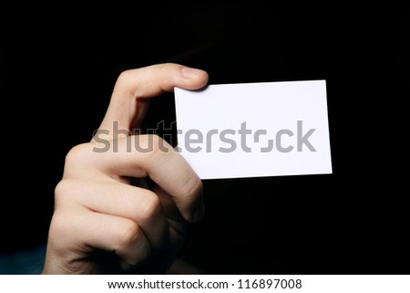 Man holding business card. Close up shot