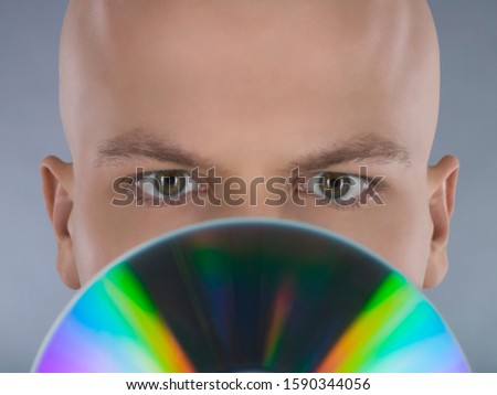 Man holding cd in front of face