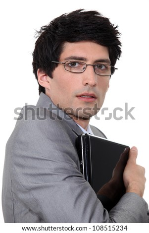 Man holding computer in his arms
