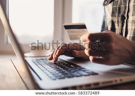 Man holding credit card and using laptop. Online shopping concept #583372489
