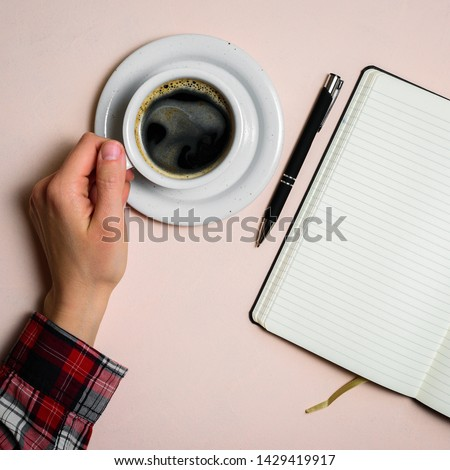 Man holding cup of coffee by left hand. Left hander day concept. Working place of lefty #1429419917