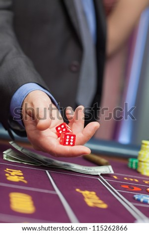 Man holding dice in his hands