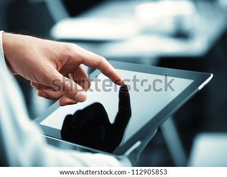 man holding digital tablet, closeup #112905853