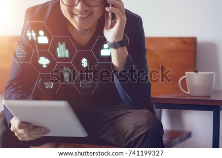 Man holding digital tablet making online shopping and banking payment. Blurred background . #741199327
