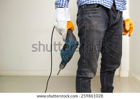 Man holding drilling tools Stock photo ©