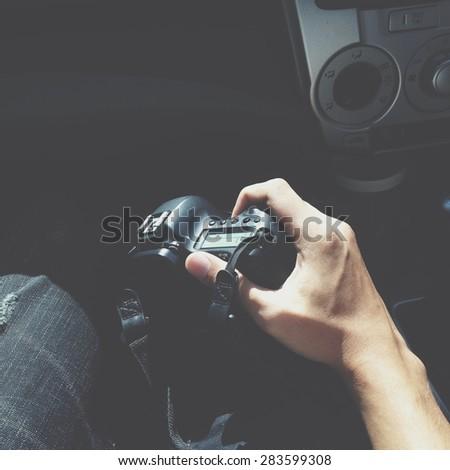 man holding DSLR camera in hand #283599308