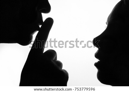 man holding finger in front of...
