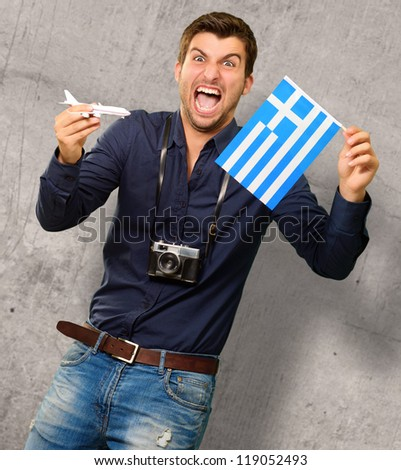 Man holding flag and miniature airplane, outdoor